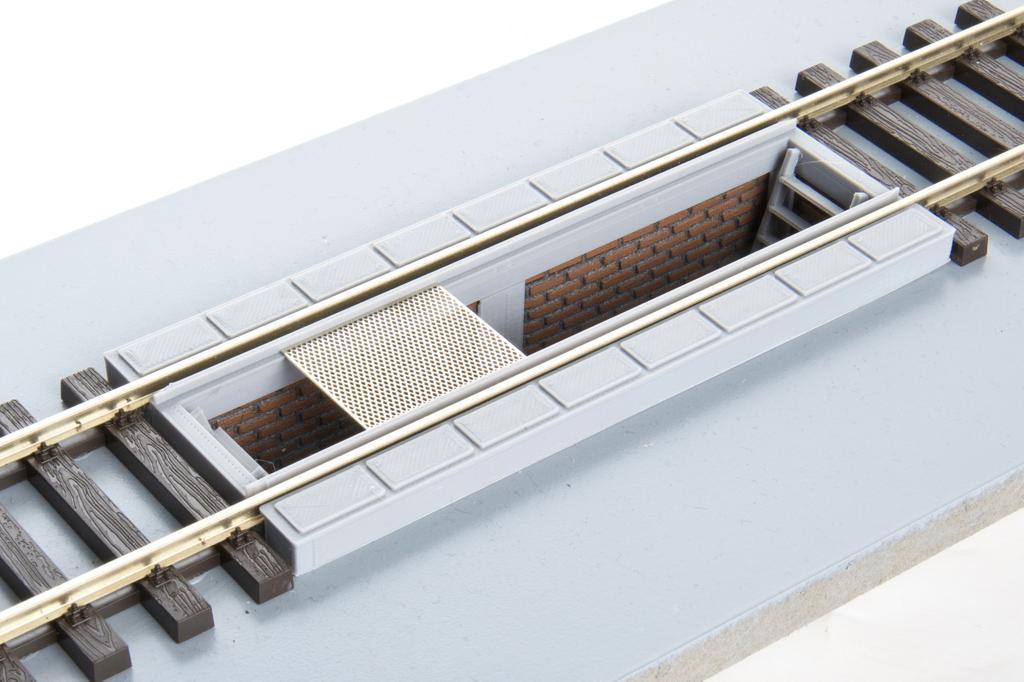 Gleisgrube mit Abdeckblech, Innenwand und Treppe